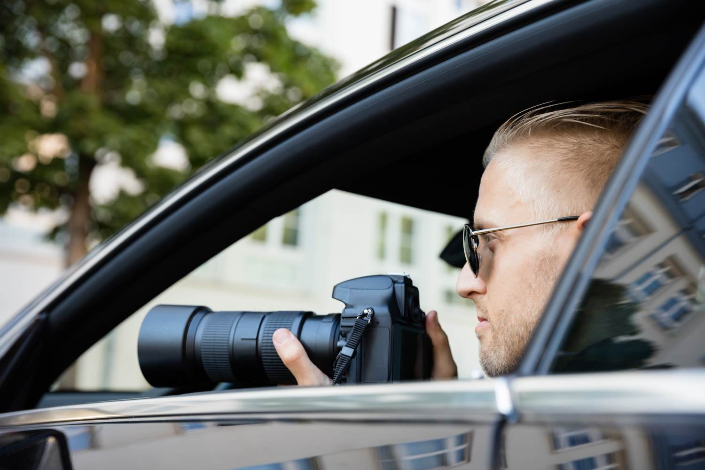 shu-surveillance-Man with camera-555970417-Andrey_Popov