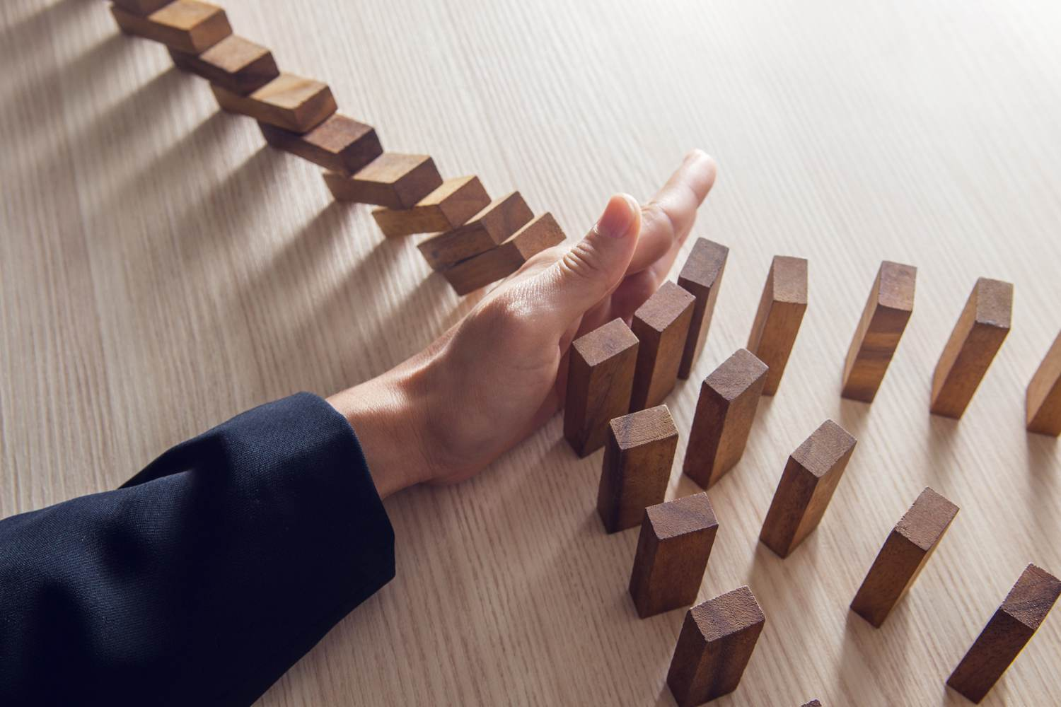 Stopping a falling domino effect - preventing corporate loss