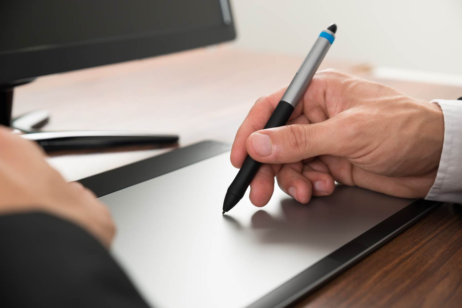 Man writing on graphic design tablet