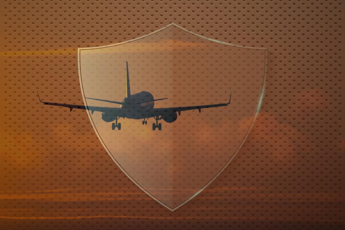 Airplane landing at the airport runway at sunset